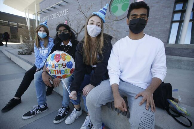 JOHN WOODS / WINNIPEG FREE PRESS</p><p>Maples Collegiate students Jamie Anderson, Isaac Nimmagadda, Rebecca Cabral and Harshveer Multani are outside the school in Winnipeg Monday. Cabral celebrated her 17th birthday with her friends before schools closed due to lockdown.</p>