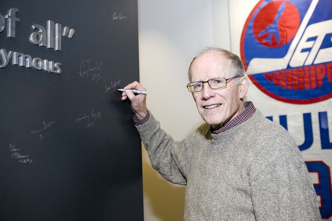 <p>supplied</p><p>Drybrough signs the Manitoba Sports Hall of Fame's signature wall following his induction in 2009.</p>