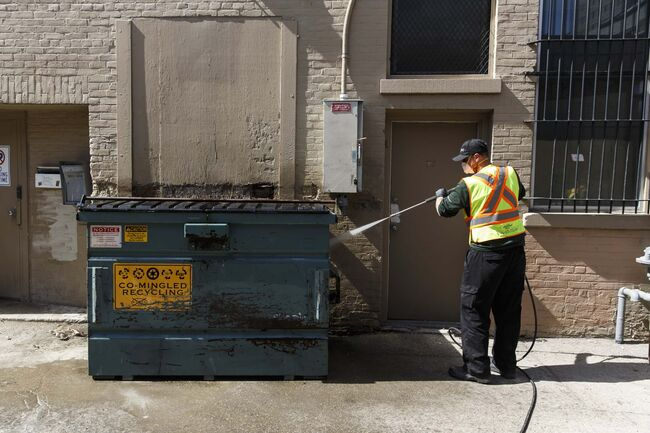 MIKE DEAL / WINNIPEG FREE PRESS						</p>																	<p>Chris Morgan, a member of the Downtown Winnipeg BIZ Enviro Team, sprays down a problem area for public urination in a back alley near Portage Avenue.						</p>