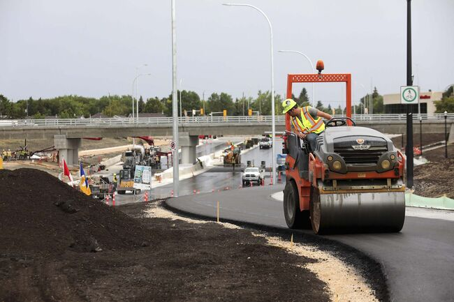 RUTH BONNEVILLE / WINNIPEG FREE PRESS</p><p>Waverley Underpass announcement Landscaping and construction crews work to do final preparations to open the Waverley underpass by Aug 19th which was officially announced at a news conference by Mayor Brian Bowman and other government officials Today. News conference location was inside the Waverley Underpass construction zone on northbound Waverley Street, just south of the new underpass on the new roadway.</p>