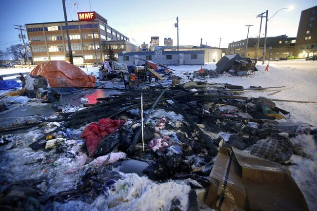 A fire destroyed a teepee in a homeless tent village at the corner of Austin and Henry Tuesday. (John Woods / Winnipeg Free Press)</p>