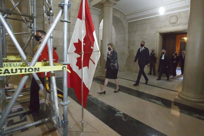 Lt.-Gov. Janice Filmon, Premier Brian Pallister and other officials pass beneath scaffolding as they head towards the chambers for the speech from the throne.