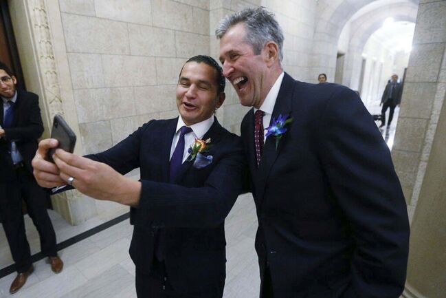 Manitoba Premier Brian Pallister, right, and Manitoba NDP Leader Wab Kinew pose for a selfie after the reading of the throne speech at the Manitoba Legislature in 2018. THE CANADIAN PRESS FILES/John Woods</p>