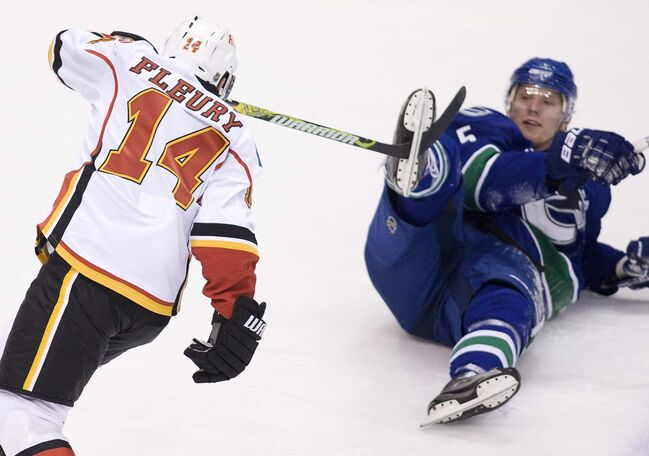 The Vancouver Canucks' Christian Ehrhoff (right) gets a taste of Fleury's grit during a game in 2009. (Jonathan Hayward / The Canadian Press files)						</p>
