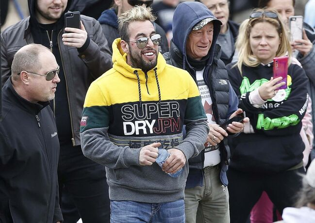 """Todd Dube, left, wasn't one of the people fined Sunday at the anti-mask rally at the Forks with speaker Chris """"Sky"""" Saccoccia."""