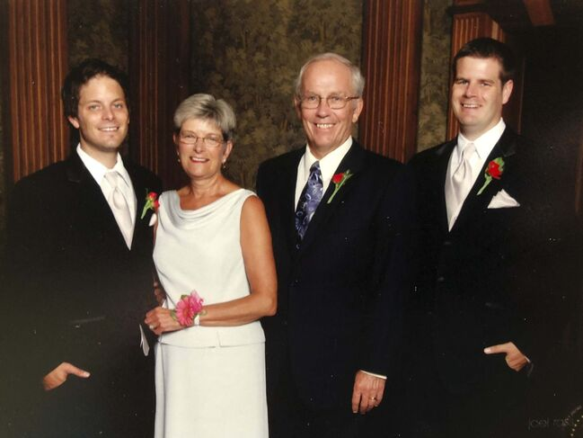 <p>supplied</p><p>Rick Borland with his wife, Heather, and sons Trev and Jon.</p>