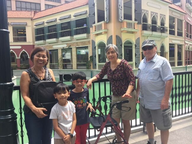 <p>SUPPLIED</p><p>Gloria (second from right) with husband Harold (right) and friends at the Venice Grand Canal Mall in Manila, Philippines. She travelled back to the country with her husband in February 2020 after being diagnosed with cancer a second time.</p>