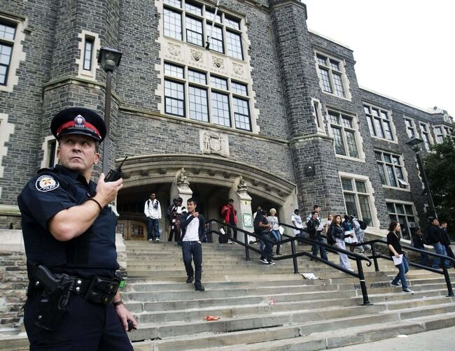 A Toronto police officer in front of Central Technical School in Toronto in 2010. In 2017 the Toronto District School Board voted to axe its decade-old, onsite police program. THE CANADIAN PRESS/Nathan Denette						</p>