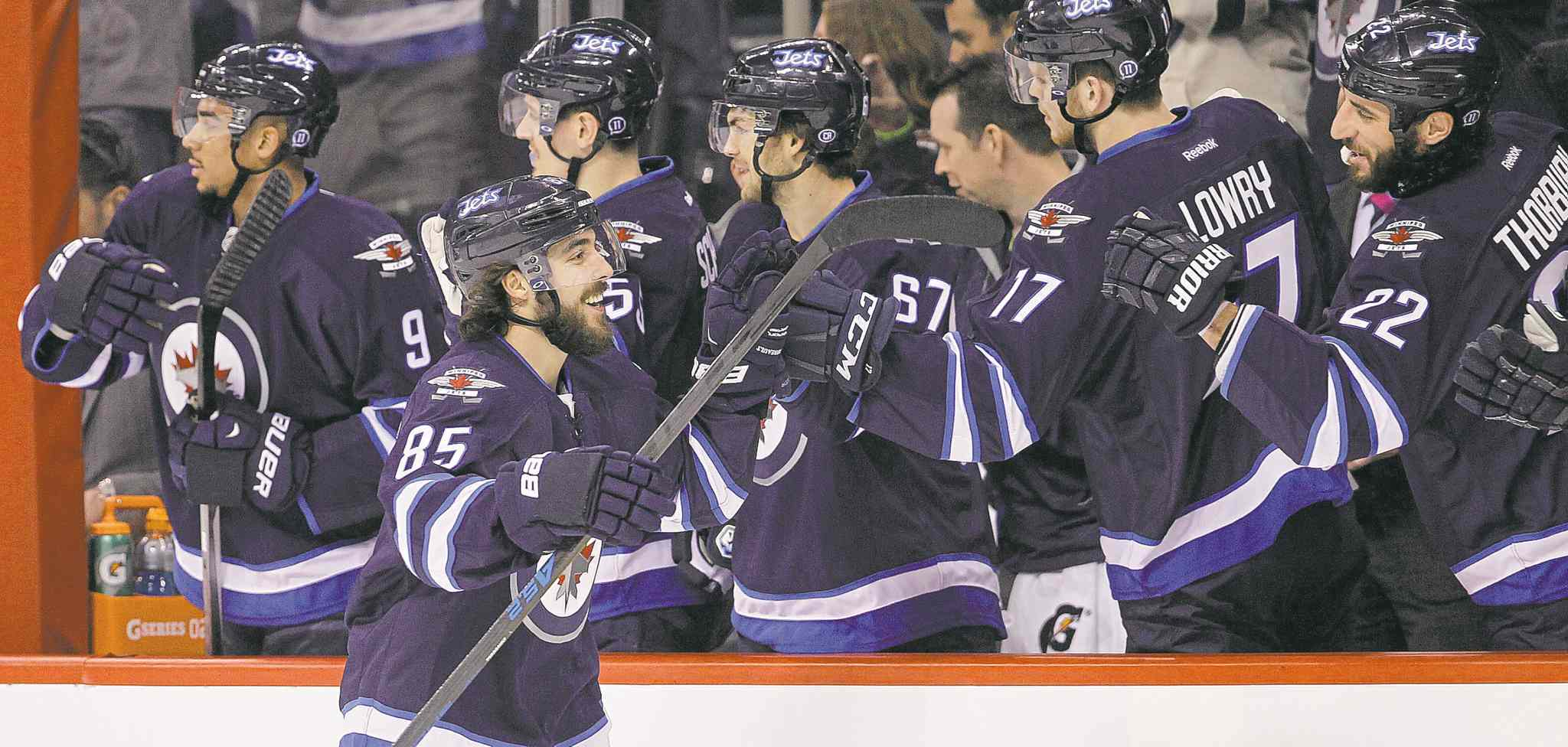 trevor hagan / the canadian press filesWinnipeg Jets forward Mathieu Perreault, seen celebrating his second of four goals against the Florida Panthers Jan. 13, said the Jets are excited to get back at the season and finish what they�ve started.