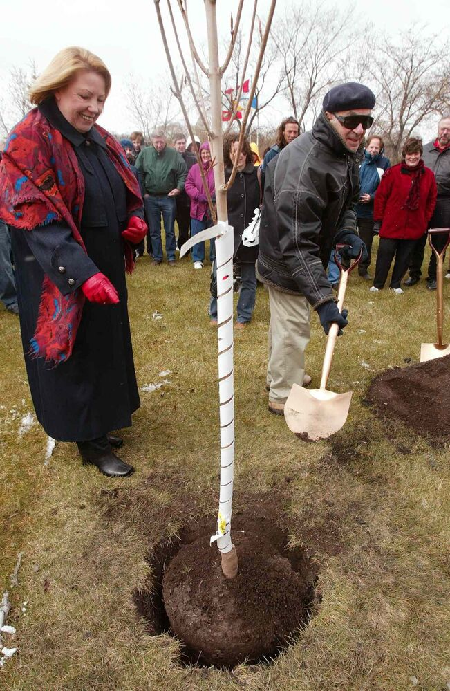 Winnipeg Free Press columist Val Werier helps plant a tree at Assiniboine Park with Dorothy Dobbie of the Coalition to Save the Elms on May 1, 2005 during the third annual Arbor Day in the Park. Werier was honoured for his work over the years in protecting trees and the enviroment. (JOE BRYKSA / WINNIPEG FREE PRESS FILES)