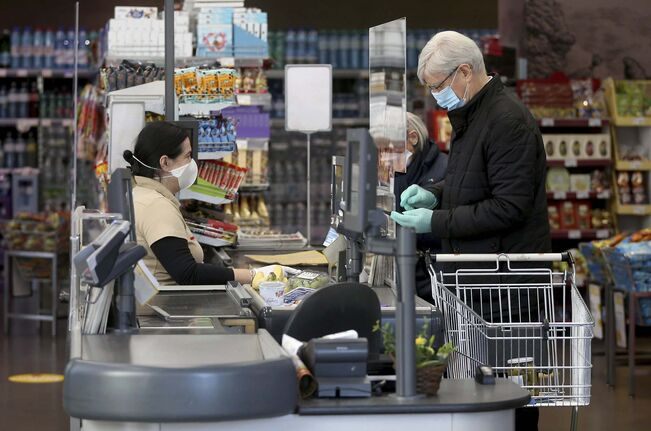 Ronald Zak / The Associated Press files</p><p>Shoppers wear protective masks in Vienna.</p>