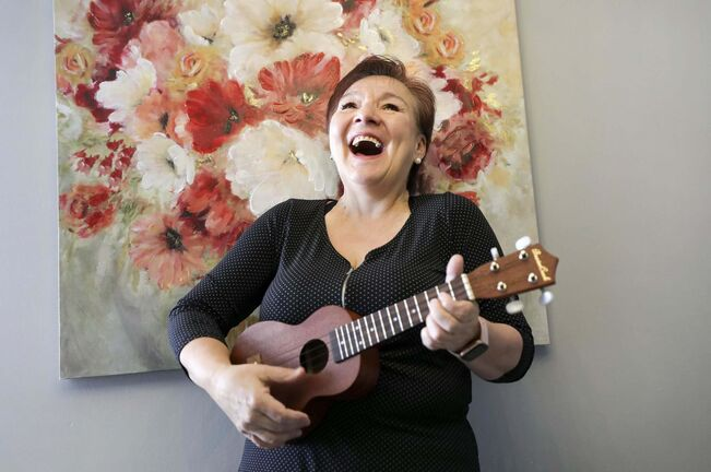 Winnipeg flight attendant Bev Watson is delighted with her ukulele.