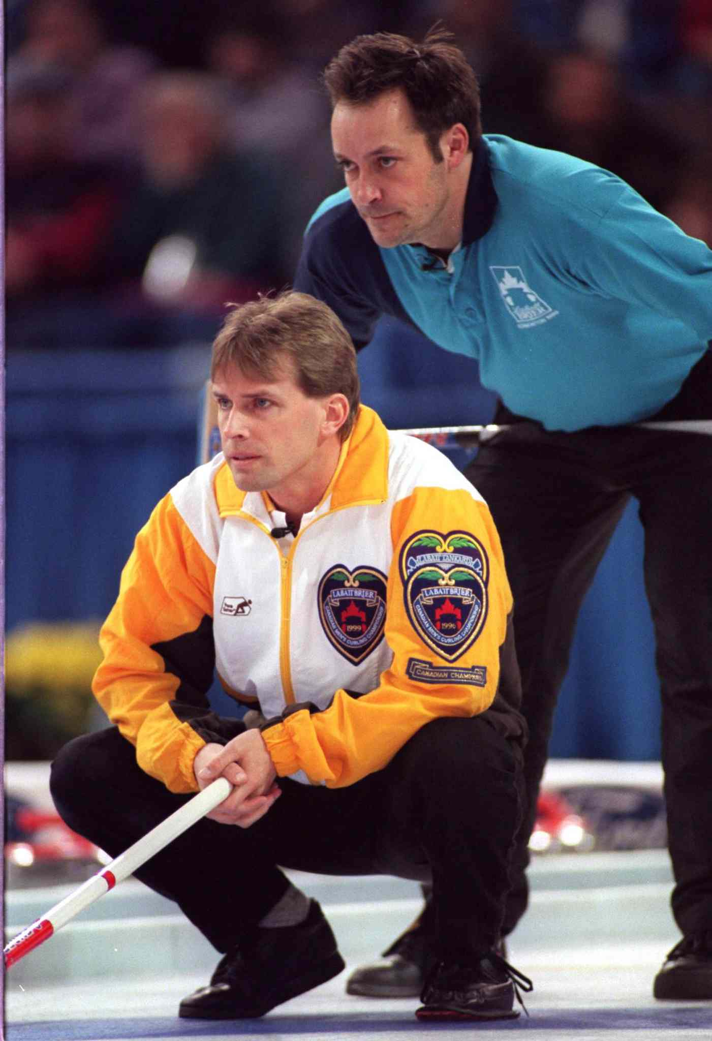 Quebec Skip Guy Hemmings looks over Manitoba Skip Jeff Stoughton's shoulder during the final of the 1999 Brier in Edmonton.