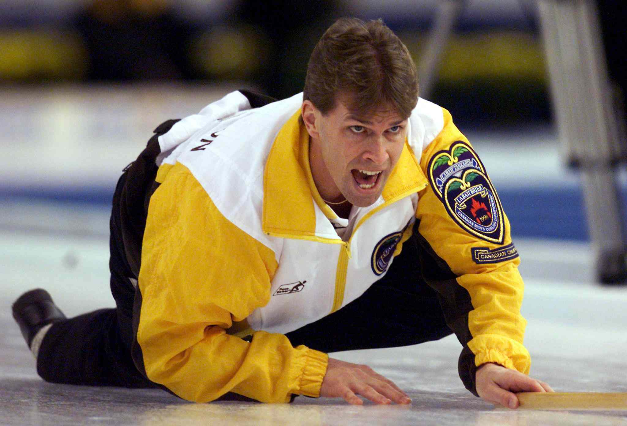 Stoughton yells for his team to sweep during the Brier final against Quebec in 1999.