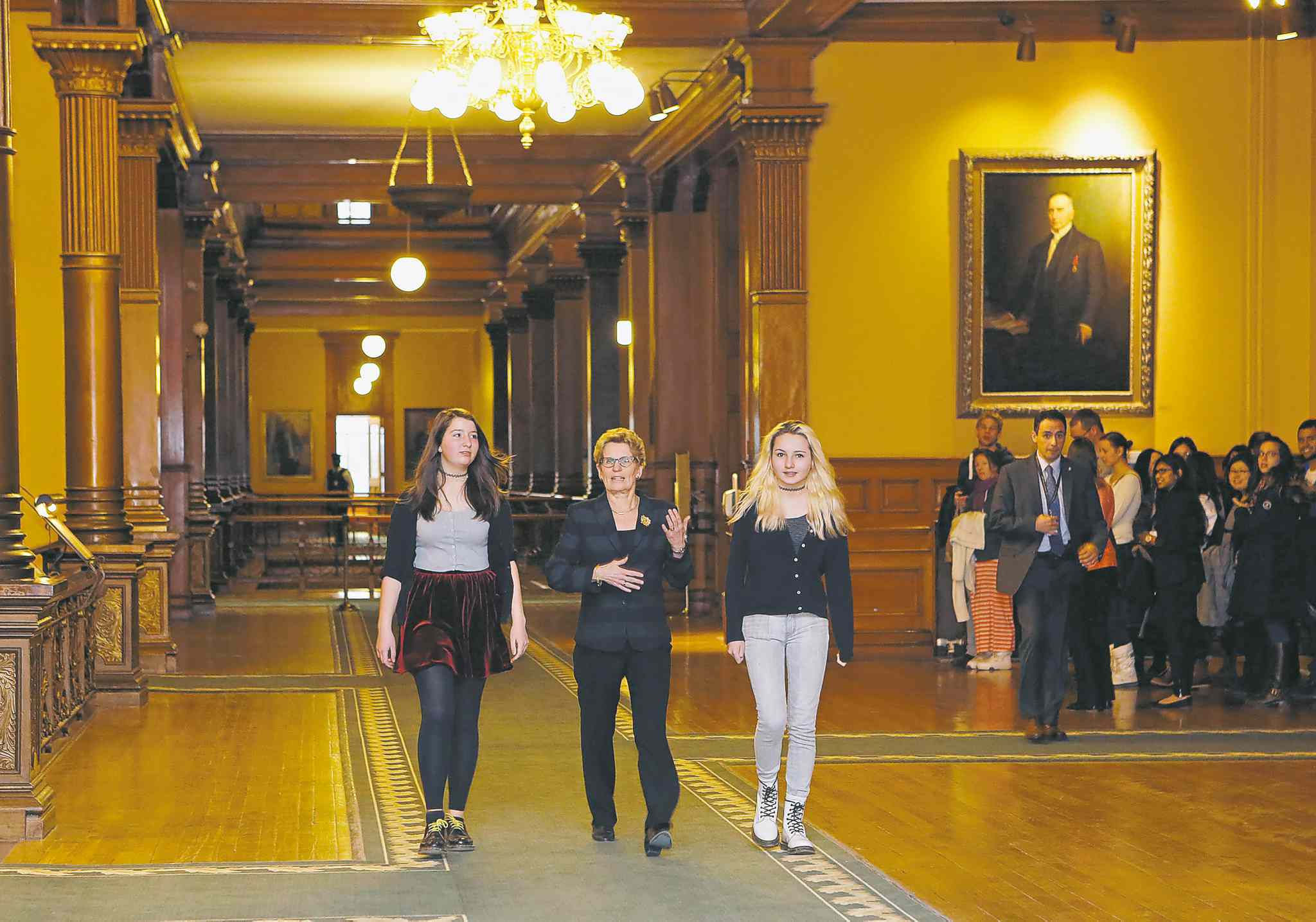 Ontario Premier Kathleen Wynne, with Tessa Hill (left) and  Lia Valente, announced a consent-based sex-ed curriculum.