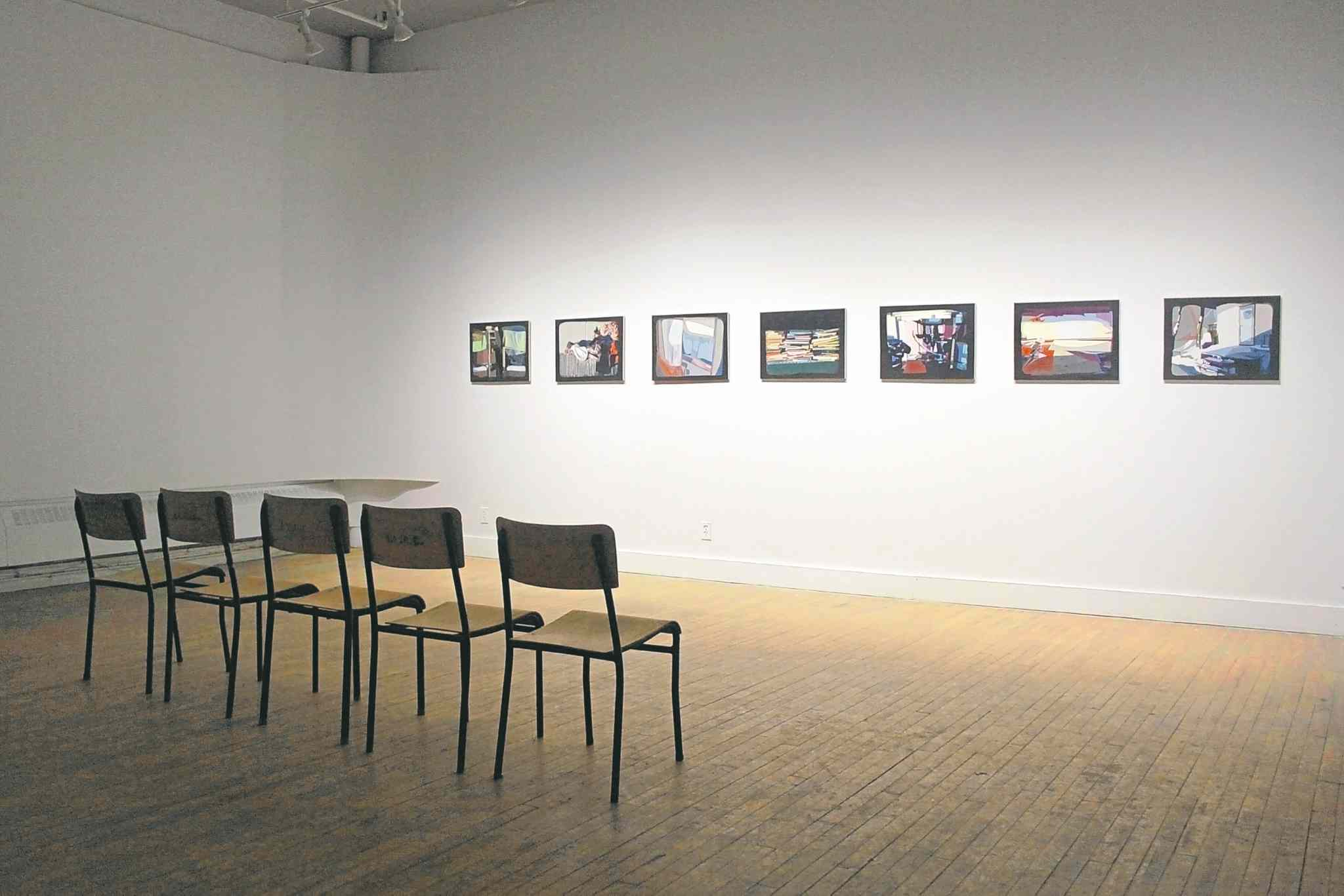Viewing area in front of collages by Irene Bindi