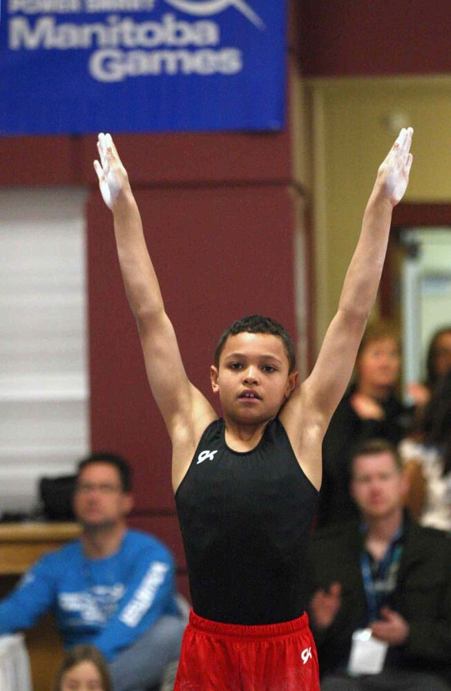 Aaron Thomas from Winnipeg Gold competes in the high bar at the Power Smart Manitoba Games Wednesday.