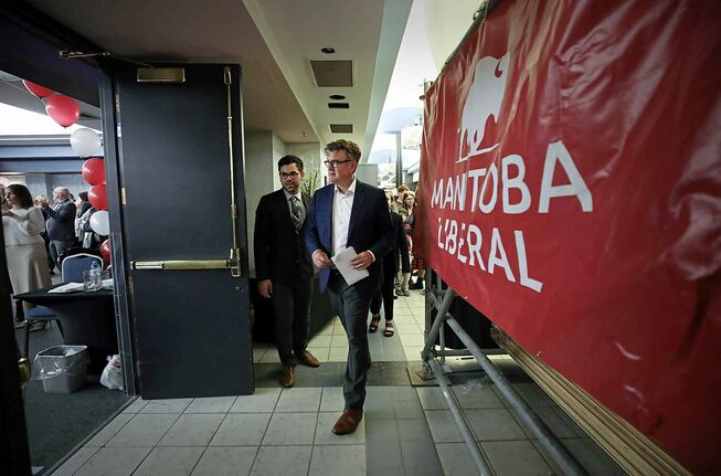 Dougald Lamont, leader of the Manitoba Liberal Party, walks into the Liberal party gathering at the Norwood Hotel as supporters cheer him on.
