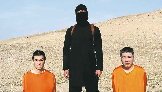 This file image taken from an online video released by IS shows the two Japanese hostages Jan. 20.