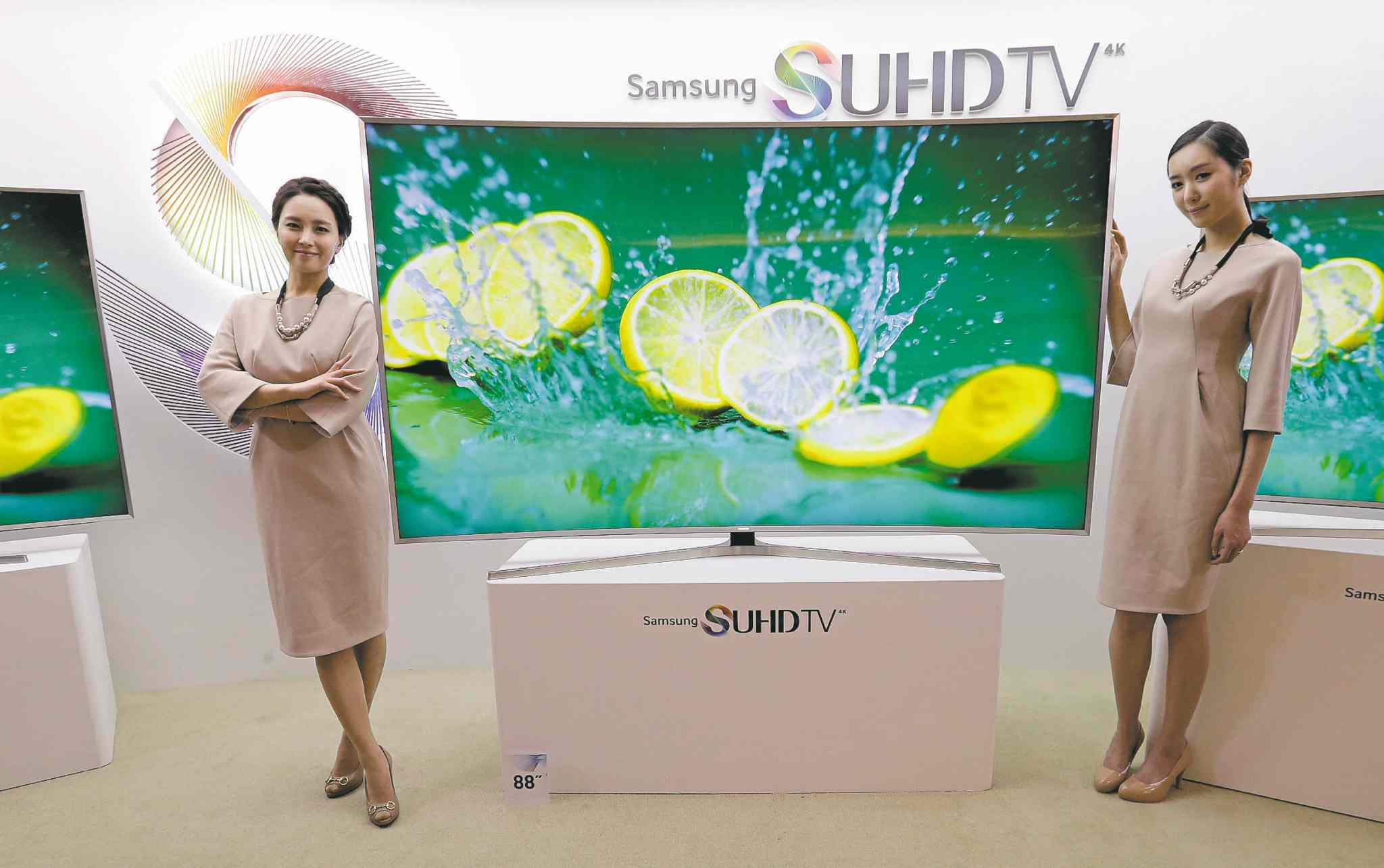 Models pose with a Samsung Electronics SUHD 4K smart TV in Seoul, South Korea. Samsung says voice-recognition technology in its Internet-connected TVs can capture and transmit nearby conversations.