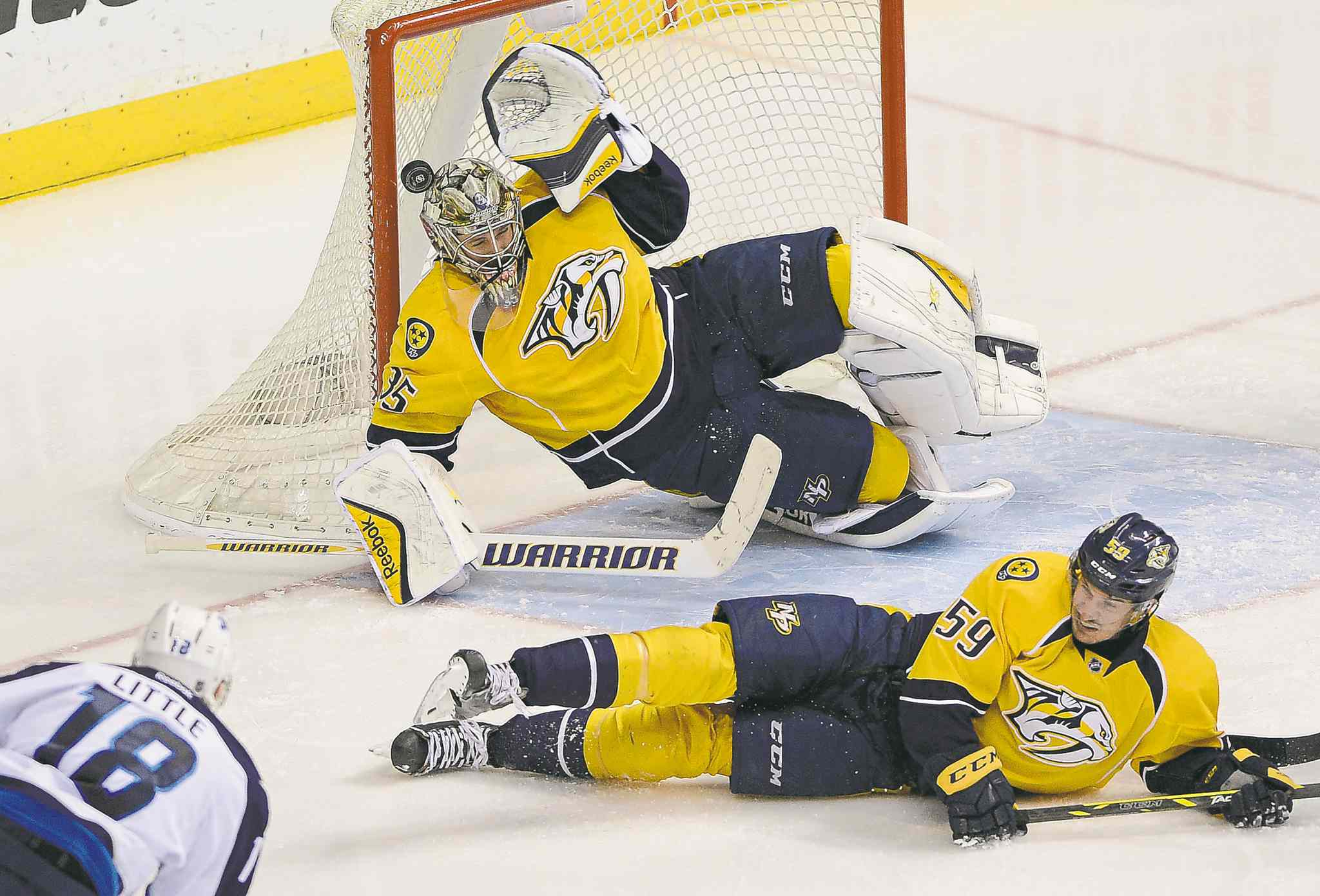 Mark Zaleski / the associated pressPredators goalie Pekka Rinne makes a diving stop on a shot from Jets centre Bryan Little, who drove the puck over blue-liner Roman Josi going for the block on the play.