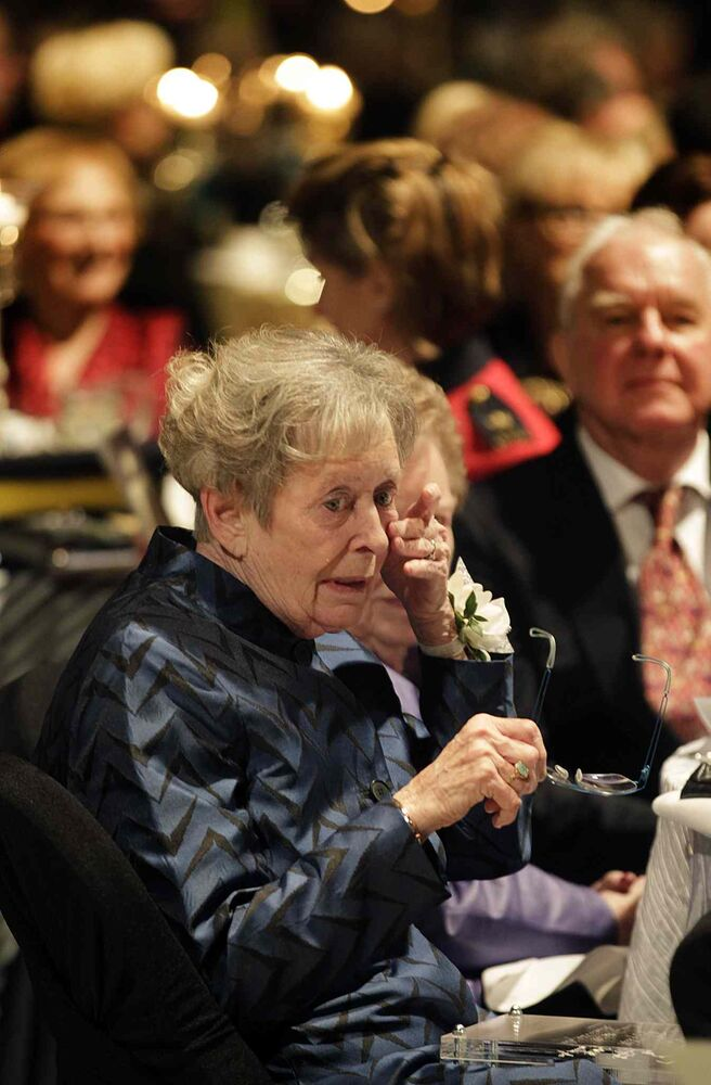 Signy Hansen, daughter of Dr Jessie Lang, wipes tears away after accepting the very first Nellie Award on behalf of her 99-year-old mother, Jessie, who was too ill to attend the Centennial Gala. (Phil Hossack / Winnipeg Free Press)