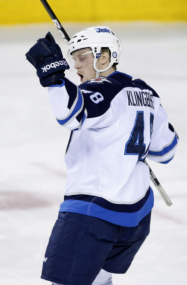 Winnipeg Jets' Carl Klingberg celebrates his first NHL goal, during the team's final game of the season, against the Calgary Flames Friday. (Larry MacDougal / The Canadian Press)