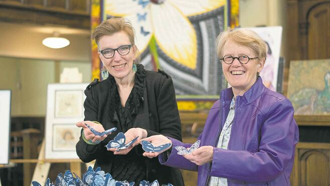 Sandi Howell, left, and Barb Janes with the blue butterflies used as part of an art installation across Manitoba and in cities around the globe.