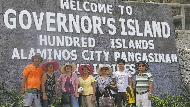 (Left to right): Johnny Camungol, Benedicta Camungol, Cecil Cruz, Mary Aquino, Nene Rojas, Jojo Aquino and this writer, pictured at Governor's Island in Hundred Islands National Park in the Philippines.