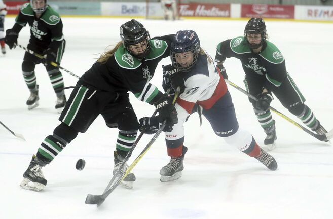 Rocky Mountain Raiders' Makena Welby (8) hits St.Mary's Academy Flames' Ashlynn Stitt (17) during a Female World Sport School Challenge game. (Trevor Hagan / Free Press files)