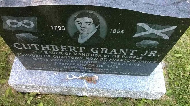 A sprig of heather was placed on Cuthbert Grant's memorial marker during an event held on July 20.