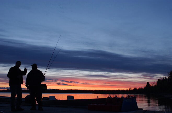 J.D. Lehr, left, of Wyoming Township, Minn., talks fishing with a Gods Lake Lodge guide just after sunset on June 10, 2007, in northeastern Manitoba. Fishing was good last week at the northern Manitoba lodge, where guests caught hundreds of trophy walleyes. (CP Photo/St. Paul Pioneer Press, Chris Niskanen)