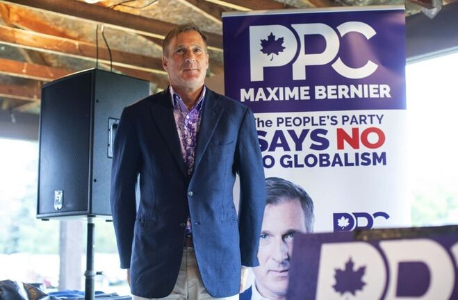 Peoples Party of Canada leader Maxime Bernier waits to speak during a rally held in Vegreville Alta., on Sunday. THE CANADIAN PRESS/Jason Franson</p>