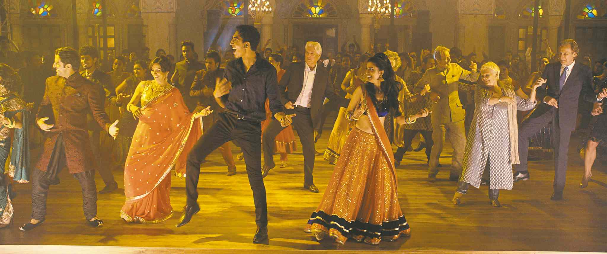 Dev Patel and Tina Desai (foreground) in colourful, lively The Second Best Exotic Marigold Hotel.
