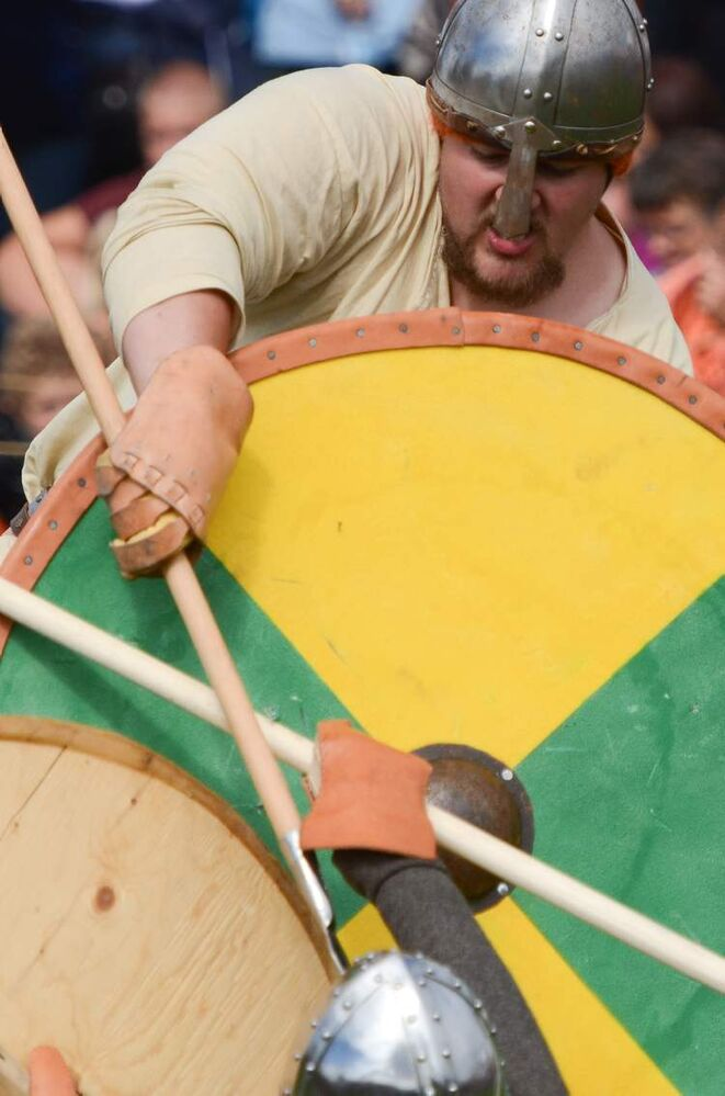 Viking reenactor Jamin Schumacher slays a foe with his short spear during a combat demonstration at the Icelandic Festival in Gimli, Saturday. (COLE BREILAND / WINNIPEG FREE PRESS)