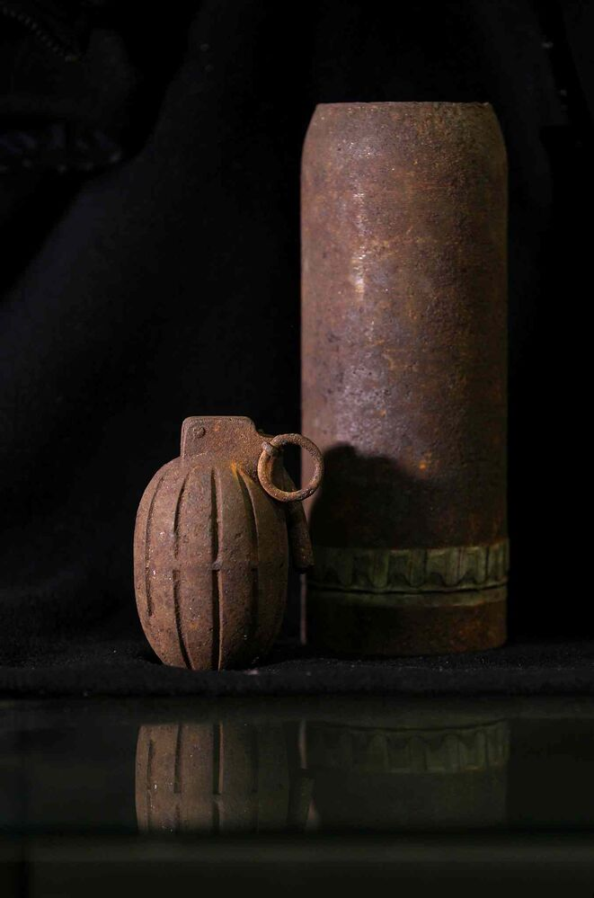 A No. 5 training Mills Bomb  and 18-pounder shrapnel shell found at Camp Hughes.    (Ruth Bonneville / Winnipeg Free Press)