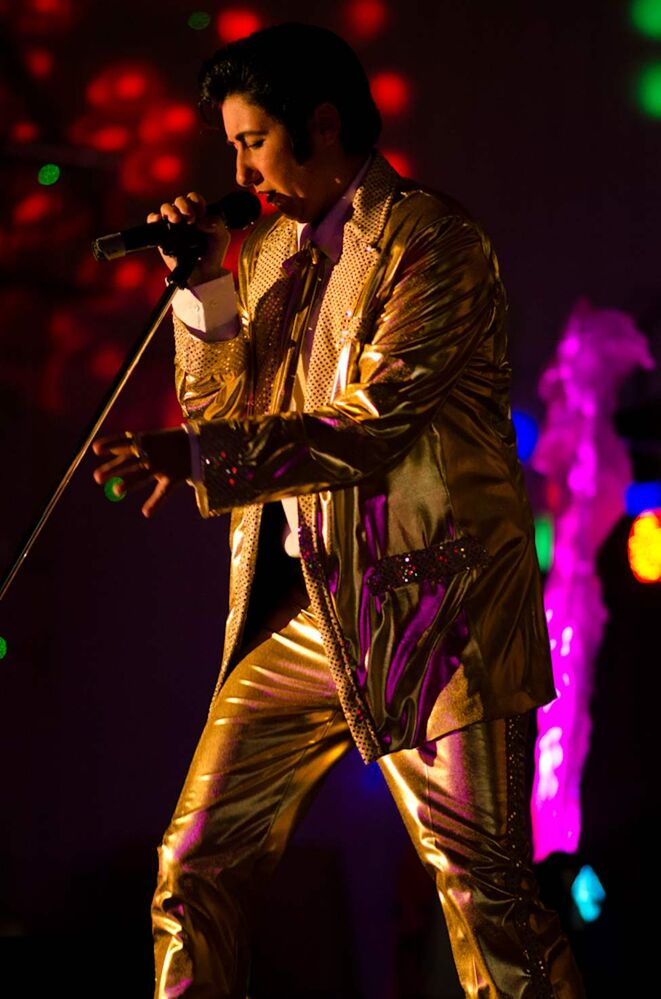 Marnie Lee Gudz performs as Miss Elvis Lee at the 11th annual Elvis Fest in Gimli, Manitoba. Elvis impersonators performed for a full Gimli recreation centre.  COLE BREILAND / WINNIPEG FREE PRESS