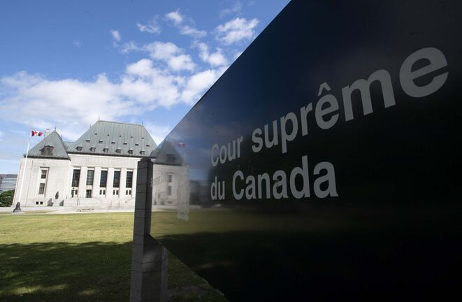 Clouds pass by the Supreme Court of Canada in Ottawa, Friday, June 12, 2020. THE CANADIAN PRESS/Adrian Wyld</p>