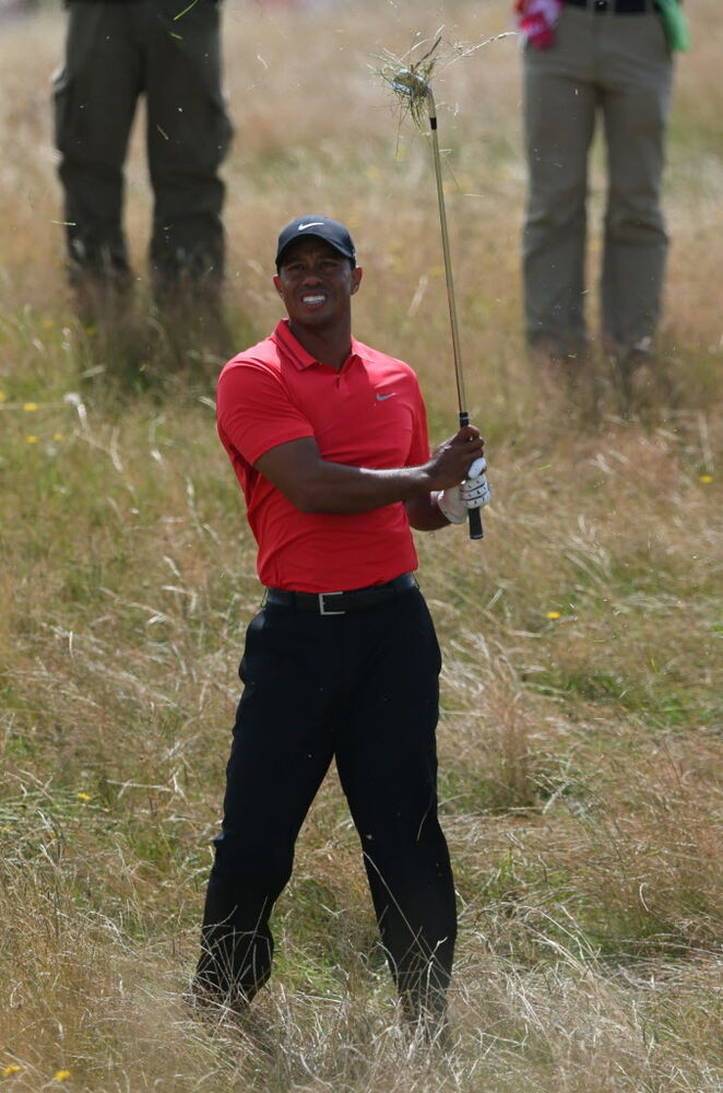 Tiger Woods of the U.S. plays out of the rough on the 12th hole during the final round of the British Open Golf championship at the Royal Liverpool golf club, Hoylake, England, Sunday.  Woods shot a disappointing 6 over par for the tournament.   (Jon Super / AP Photo)