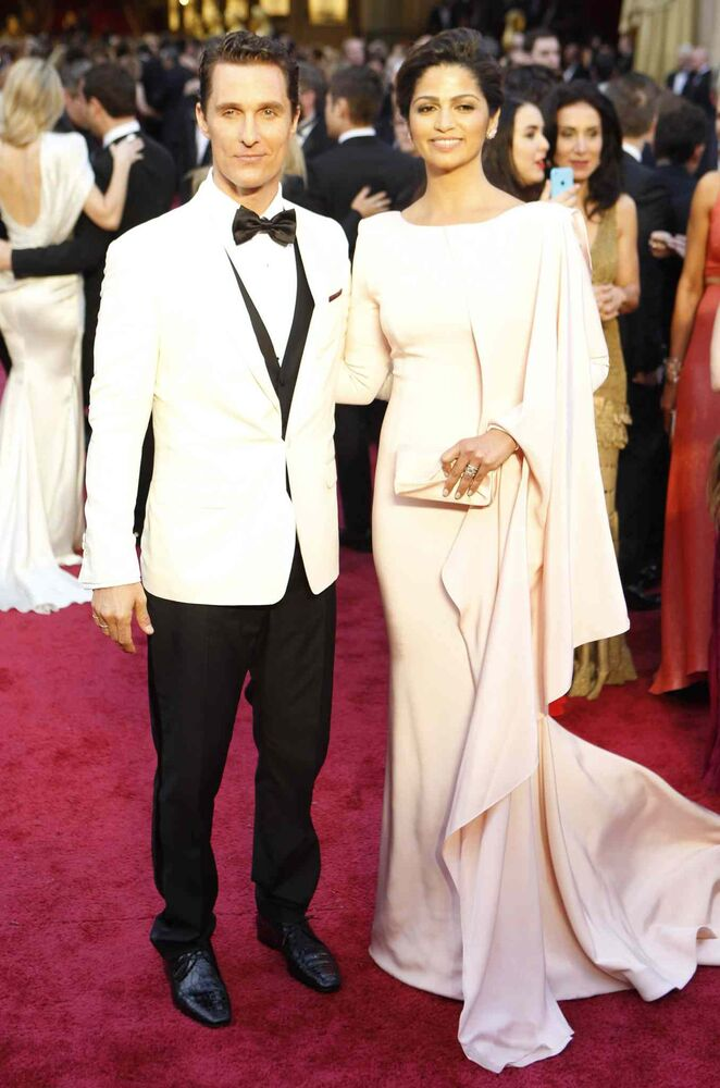 Matthew McConaughey and Camila Alves arrive at the 86th annual Academy Awards at the Dolby Theatre at Hollywood & Highland Center in Los Angeles. (Wally Skalij / Tribune Media MCT)