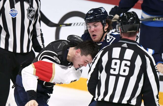 MacKenzie Weegar (left) and Brendan Lemieux duke it out Friday. Lemieux would later be assessed a match penalty for an illegal hit to the head of Vincent Trocheck and was kicked out of the game. (Martti Kainulainen / Lehtikuva)</p>