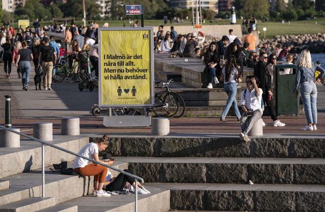 People enjoy the warm evening weather in Malmo, Sweden, Tuesday May 26, 2020. Sweden has defended its response to the COVID-19 global pandemic despite the country now reporting one of the highest mortality rates in the world with 4,125 fatalities, about 40 deaths per 100,000 people. ( Johan Nilsson/TT via AP)