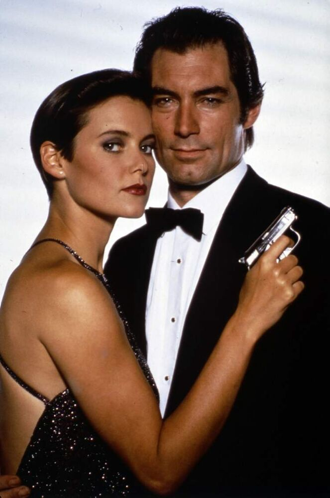 Timothy Dalton, as James Bond, right, and Carey Lowell as Pam Bouvier in Licence To Kill (1989).  Along with sports cars, gadgets and sex appeal, an impeccable sense of style is a hallmark of the James Bond movie franchise.