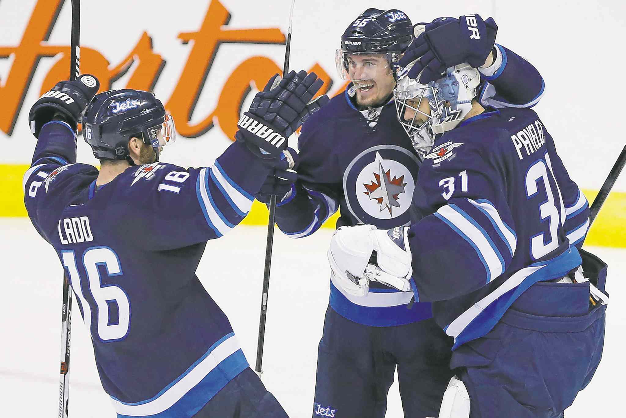 John Woods / THE CANADIAN PRESSAndrew Ladd, Mark Scheifele (middle) and goaltender Ondrej Pavelec whoop it up after Thursday�s thrilling comeback victory.
