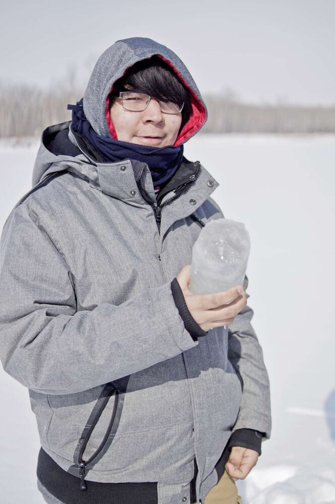 Denzel Harper, a student at Southeast Collegiate, holds an ice core sample taken from Lake Cargill on Arctic Science Day at FortWhyte Alive. Over 150 students from across the province came to the nature conservation centre to learn about Arctic research.  (Danielle Da Silva - Sou'wester)