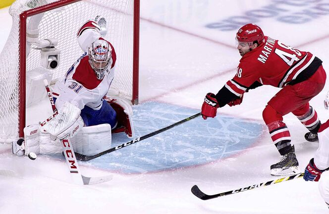 Montreal Canadiens goaltender Carey Price stops Carolina Hurricanes' Jordan Martinook during second period NHL hockey action in Montreal on Thursday, December 13, 2018. THE CANADIAN PRESS/Paul Chiasson