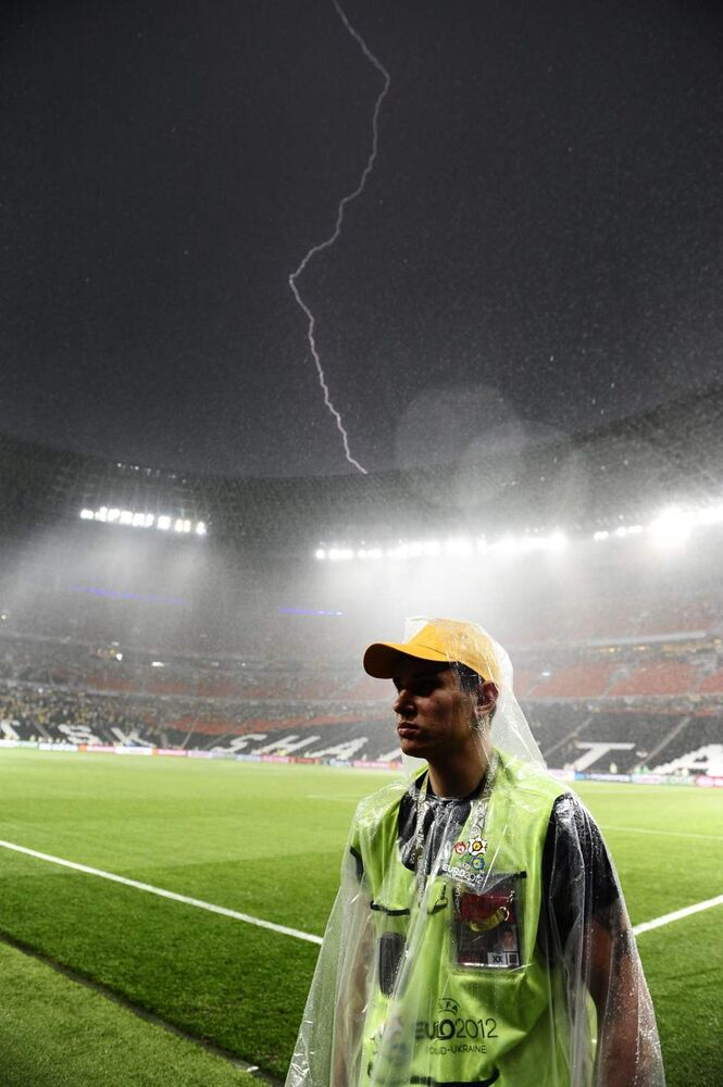 Lightning strikes during the Euro 2012 soccer championship Group D match between Ukraine and France in Donetsk, Ukraine, Friday, June 15, 2012. The match was suspended due to heavy rain. (Manu Fernandez / The Associated Press)
