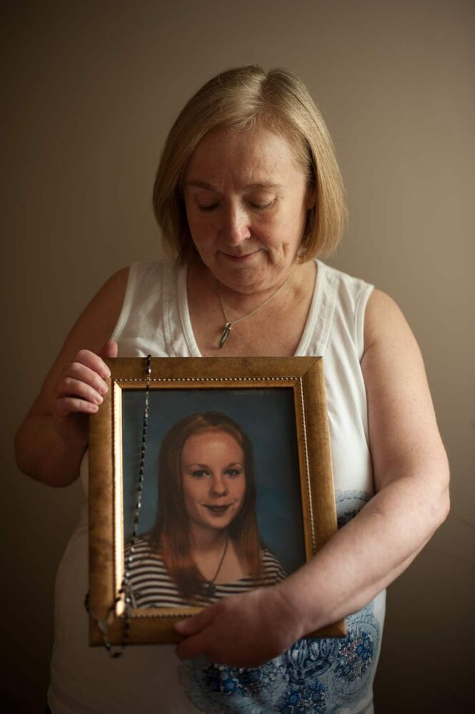 Elaine Stevenson holds a portrait of her daughter Alyssa with her rosary draped over it as it hangs in the family home on June 1st, 2012. Stevenson got the rosary from her grandmother, whom Alyssa was very close with. (Cole Breiland/ Winnipeg Free Press)