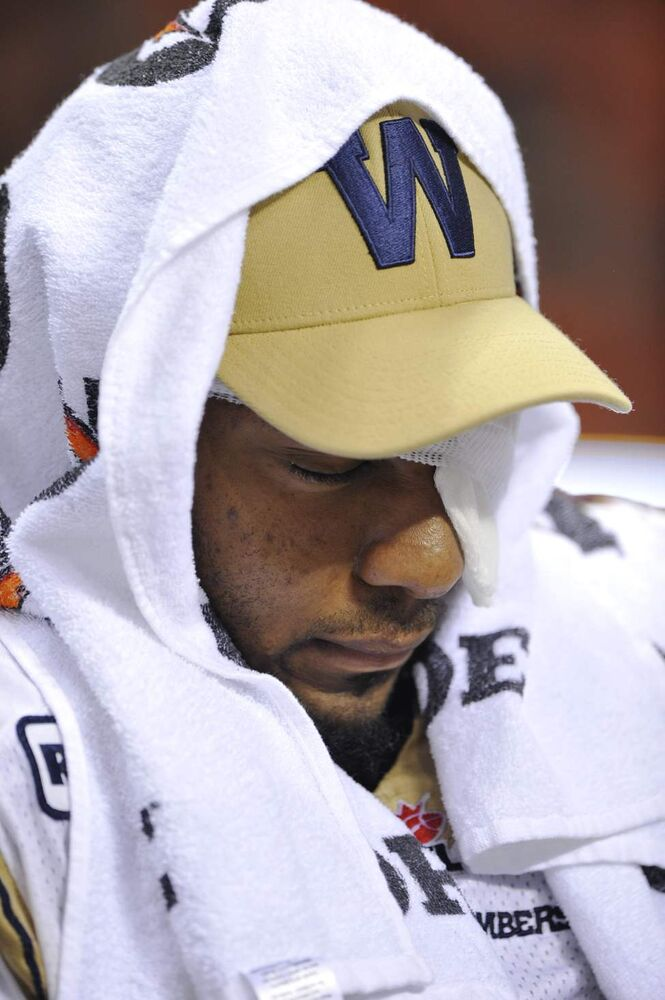 Winnipeg Blue Bombers Bryant Turner sits on the bench after being injured during his team's 34-23 loss of the 2011 Grey Cup final against the B.C. Lions in Vancouver.  (Jenelle Schneider / Postmedia News)