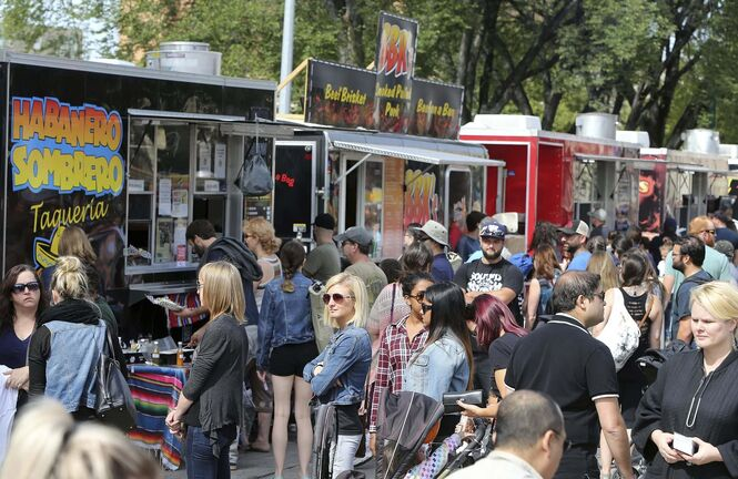 Jason Halstead / Winnipeg Free Press files</p><p>Crowds line up for food trucks at Manyfest on Broadway.</p>
